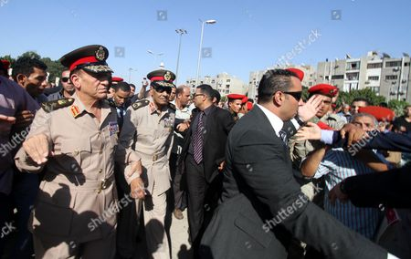 Head of Military Council Field Marshal Mohammed Hussein Tantawi (c) and Armed Forces Chief of Staff Sami Anan (l) Arrive to Attend the Funeral of Former Intelligence Chief and Vice-president of Former Egyptian President Hosni Mubarak Omar Suleiman in Cairo Egypt 21 July 2012 Several Hundred Mourners Attended the Funeral Prayers and Followed the Coffin Through the Capital They Chanted Slogans Against President Mohamed Morsi and His Muslim Brotherhood Group Suleiman Has Died in a Us Hospital on 19 July 2012 Egypt Cairo