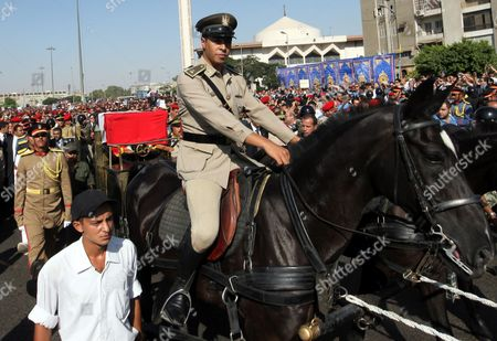 A Mounted Soldier Looks on As Other Military Personel March Next to the Coffin of Former Intelligence Chief and Vice-president of Former Egyptian President Hosni Mubarak Omar Suleiman During His Funeral in Cairo Egypt 21 July 2012 Souleiman Has Died in a Us Hospital on 19 July 2012 Egypt Cairo