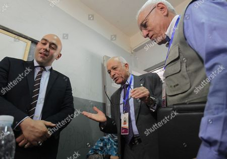 Arab League Secretary General Nabil Alaraby (c) and the Head of the Arab League Observers Delegation For the Presidential Elections in Egypt Mohamed El-khamlisy of Morocco (r) Speak with an Official in Charge of a Polling Station As They Visit It During the First Round of the Presidential Elections in Cairo Egypt 24 May 2012 the Arab League Sent a Delegation of Some 50 Members to Follow the Proceedings of the Vote in the Elections Egypt Cairo