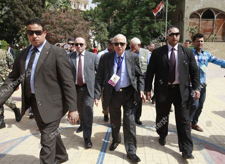 Arab League Secretary General Nabil Alaraby (c) and the Head of the Arab League Observers Delegation For the Presidential Elections in Egypt Mohamed El-khamlisy of Morocco (3-r) Arrive to Visit a Polling Station During the First Round of the Presidential Elections in Cairo Egypt 24 May 2012 the Arab League Sent a Delegation of Some 50 Members to Follow the Proceedings of the Vote in the Elections Egypt Cairo