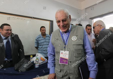 The Head of the Arab League Observers Delegation For the Presidential Elections in Egypt Mohamed El-khamlisy of Morocco (c) and Arab League Secretary General Nabil Alaraby (r) Visit a Polling Station During the First Round of the Presidential Elections in Cairo Egypt 24 May 2012 the Arab League Sent a Delegation of Some 50 Members to Follow the Proceedings of the Vote in the Elections Egypt Cairo