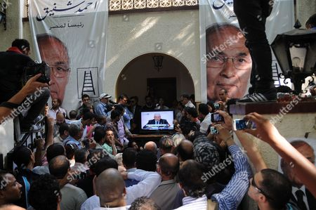 Supporters of Egyptian Presidential Candidate Ahmed Shafiq (depicted in Poster) Watch the Announcement of the Eletions Result on Television at His Campaign Headquarter in Cairo Egypt 24 June 2012 the Muslim Brotherhood's Mohammed Morsi Became Egypt's First Freely Elected President the Election Commission Said Sparking Mass Celebrations in Cairo where Tens of Thousands of His Supporters Had Gathered Morsi an Engineering Professor Won 51 73 Per Cent of Votes in the June 16-17 Presidential Run-off Commission Head Farouk Sultan Said Egypt Cairo