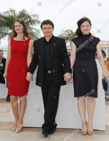 (l-r) Actress Cristina Flutur Romanian Director Cristian Mungiu and Actress Cosmina Stratan Pose During the Photocall For 'Dupa Dealuri' (beyond the Hills) at the 65th Cannes Film Festival in Cannes France 17 May 2012 the Movie is Presented in the Official Competition of the Festival Which Runs From 16 to 27 May France Cannes