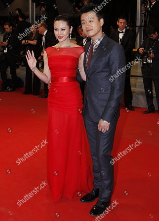 Chinese Actor Tong Dawei (r) and His Wife Guan Yue Arrive For the Screening of 'Baad El Mawkeaa' (after the Battle) During the 65th Cannes Film Festival in Cannes France 17 May 2012 the Movie is Presented in the Official Competition of the Festival Which Runs From 16 to 27 May France Cannes