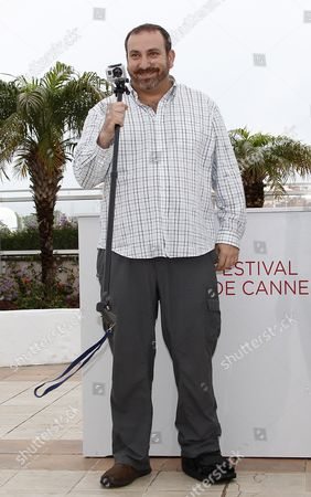 Actor Hernan Mendoza Holds a Camera As He Poses During the Photocall For 'Despues De Lucia' at the 65th Cannes Film Festival in Cannes France 21 May 2012 the Movie is Presented in the 'Un Certain Regard' Section of the Festival Which Runs From 16 to 27 May France Cannes