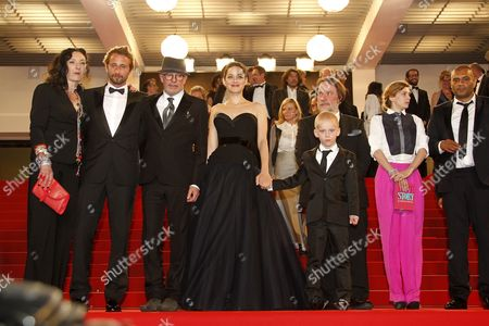 (l-r) French Actress Corinne Masiero Belgian Actor Matthias Schoenaerts French Director Jacques Audiard French Actress Marion Cotillard Actor Armand Verdure Belgian Actor Bouli Lanners French Actress Celine Sallette and Actor Jean-michel Correia Leave the Screening of 'De Rouille Et D'os' (rust and Bone) During the 65th Cannes Film Festival in Cannes France 17 May 2012 the Movie was Presented in the Official Competition of the Festival Which Runs From 16 to 27 May France Cannes