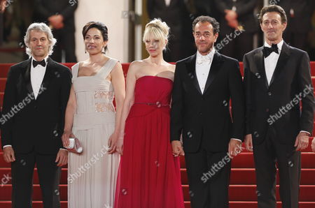 Stock Photo of Italian Director Matteo Garrone (2-r) Italian Actress Loredana Simioli (2-l) Italian Actor Nando Paone (r) and Guests Arrive For the Screening of 'Reality' During the 65th Cannes Film Festival in Cannes France 18 May 2012 the Movie is Presented in the Official Competition of the Festival Which Runs From 16 to 27 May France Cannes
