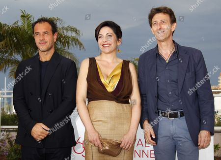 (l-r) Italian Director Matteo Garrone Italian Actress Loredana Simioli and Italian Actor Nando Paone Pose During the Photocall For 'Reality' at the 65th Cannes Film Festival in Cannes France 18 May 2012 the Movie is Presented in the Official Competition of the Festival Which Runs From 16 to 27 May France Cannes