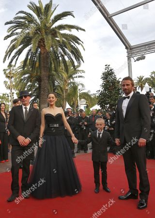 (r-l) Belgian Actor Matthias Schoenaerts and Young Actor Armand Verdure French Actress Marion Cotillard and French Director Jacques Audiard Arrive For the Screening of 'De Rouille Et D'os' (rust and Bone) During the 65th Cannes Film Festival in Cannes France 17 May 2012 the Movie is Presented in the Official Competition of the Festival Which Runs From 16 to 27 May France Cannes