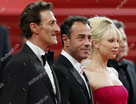 Italian Director Matteo Garrone (c) Italian Actor Nando Paone (l) and a Guest Arrive For the Screening of 'Reality' During the 65th Cannes Film Festival in Cannes France 18 May 2012 the Movie is Presented in the Official Competition of the Festival Which Runs From 16 to 27 May France Cannes