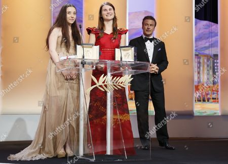 Actresses Cosmina Stratan (l) and Valeriu Andriuta (c) Receive the Best Performance by an Actress Awards For 'Dupa Dealuri' (beyond the Hills) From Us Actor Alec Baldwin (r) During the Closing Award Ceremony of the 65th Cannes Film Festival in Cannes France 27 May 2012 the Award Ceremony is Followed by the Screening of 'Therese Desqueyroux' Presented out of Competition France Cannes