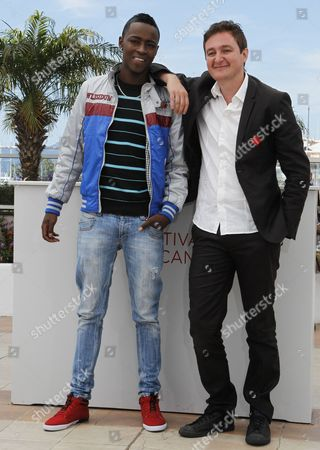 Stock Photo of Colombian Director Juan Andres Arango (r) and Actor Luis Carlos Guevara (l) Pose During the Photocall For 'La Playa Dc' at the 65th Cannes Film Festival in Cannes France 24 May 2012 the Movie is Presented in the 'Un Certain Regard' Section of the Festival Which Runs From 16 to 27 May France Cannes