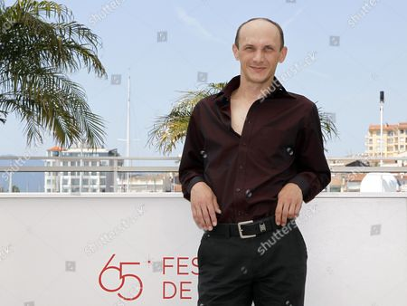 Stock Photo of Actor Sergei Kolesov Poses During the Photocall For 'V Tumane' (in the Fog) at the 65th Cannes Film Festival in Cannes France 25 May 2012 the Movie is Presented in the Official Competition of the Festival Which Runs From 16 to 27 May France Cannes