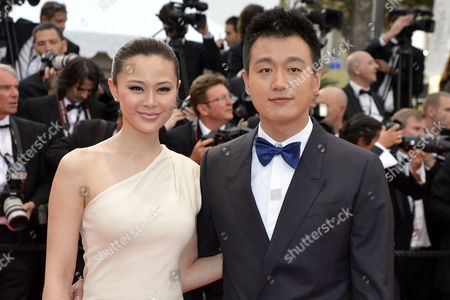Chinese Actor Tong Dawei (r) and His Wife Guan Yue Arrive For the Screening of 'De Rouille Et D'os' (rust and Bone) During the 65th Cannes Film Festival in Cannes France 17 May 2012 the Movie is Presented in the Official Competition of the Festival Which Runs From 16 to 27 May France Cannes