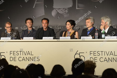 Italian Actor Nando Paone (2-l) Italian Director Matteo Garrone (3-l) and Italian Actress Loredana Simioli (3-r) Attend the Press Conference For 'Reality' During the 65th Cannes Film Festival in Cannes France 18 May 2012 the Movie is Presented in the Official Competition of the Festival Which Runs From 16 to 27 May France Cannes