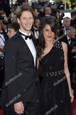 French Formula One Driver Romain Grosjean (l) and Girlfriend French Tv Host Marion Jolles (r) Arrive For the Screening of 'Killing Them Softly' During the 65th Cannes Film Festival in Cannes France 22 May 2012 the Movie is Presented in the Official Competition of the Festival Which Runs From 16 to 27 May France Cannes