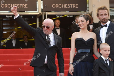 Stock Photo of Belgian Actor Matthias Schoenaerts (r) and Young Actor Armand Verdure French Actress Marion Cotillard (2-l) and French Director Jacques Audiard (l) Arrive For the Screening of 'De Rouille Et D'os' (rust and Bone) During the 65th Cannes Film Festival in Cannes France 17 May 2012 the Movie is Presented in the Official Competition of the Festival Which Runs From 16 to 27 May France Cannes