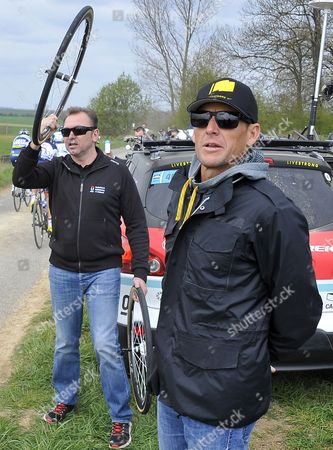 Radioshack Nissan Team Manager Belgian Johan Bruyneel (l) and Former Cyclist Us Lance Armstrong (r) Watch the Race at the Cobble Stones During the 110th Paris Roubaix Cycling Race in Roubaix France 8 April 2012 France Roubaix