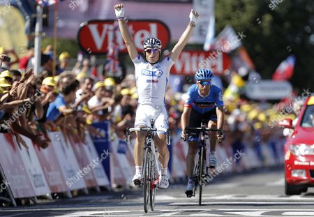 Fdj-bigmat Procycling Team Rider Pierrick Fedrigo of France (l) Celebrates in Front of Garmin-sharp Procycling Team Rider Christian Vandevelde Us (r) After Winning the 15th Stage of the Tour De France 2012 Cycling Race Between Samatan and Pau France 16 July 2012 France Pau