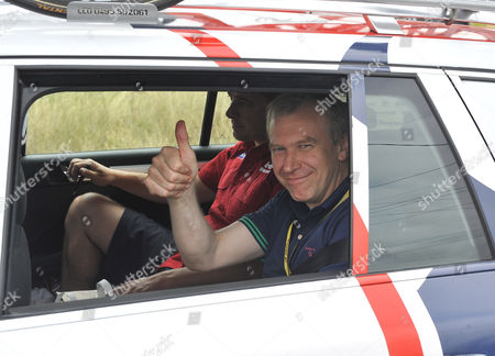 Former Belgian Prime Minister Yves Leterme Gestures Inside a Lotto-belisol Procycling Car During the 18th Stage of the Tour De France 2012 Cycling Race Between Blagnac and Brive-la-gaillarde France 20 July 2012 France Blagnac