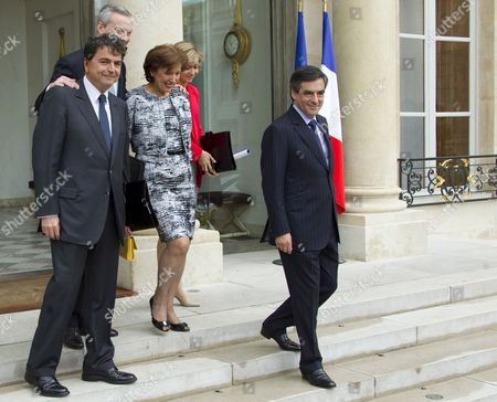 (l-r) France's Junior Minister For Foreign Trade Pierre Lellouche French Agriculture Minister Bruno Le Maire French Minister For Social Cohesion Roselyne Bachelot French Budget Minister Valerie Pecresse French Prime Minister Francois Fillon Pose on the Steps As They Leave the Elysee Palace After Their Final Government Cabinet Meeting in Paris 09 May 2012 Fillon Announced That He Will Present His Government's Resignation to Outgoing President Nicolas Sarkozy Ahead of the Official Presidency Hand-over to President-elect Francois Hollande to Be Held 15 May France Paris