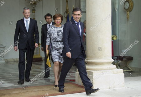 French Prime Minister Francois Fillon (r) French Minister For Social Cohesion Roselyne Bachelot (2-r) France's Junior Minister For Foreign Trade Pierre Lellouche (2-l) and French Agriculture Minister Bruno Le Maire (l) Leave the Elysee Palace After Their Final Government Cabinet Meeting in Paris 09 May 2012 Fillon Announced That He Will Present His Government's Resignation to Outgoing President Nicolas Sarkozy Ahead of the Official Presidency Hand-over to President-elect Francois Hollande to Be Held 15 May France Paris