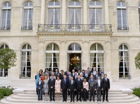French President Francois Hollande (c) Poses For a Family Picture with Members of His New Government After Their First Cabinet Meeting at the Elysee Palace in Paris France 17 May 2012 From Top (1st Row L to R) Junior Minister For Smes Innovations and Digital Economy Fleur Pellerin; Junior Minister For French Living Abroad and Francophony Yamina Benguigui; Junior Minister For Disabled People Marie-arlette Carlotti; Junior Minister For Social and Solidarity Economy Benoit Hamon; Junior Minister For the Elderly and Disabled Michele Delaunay; Junior Minister For Cities Francois Lamy; Junior Minister For European Affairs Bernard Cazeneuve; Junior Minister For Handicraft Tourism and Trade Sylvia Pinel; Junior Minister For Family Dominique Bertinotti; Junior Minister For Foreign Countries and Development Pascal Canfin; Junior Minister For Transports and Maritime Economy Frederic Cuvillier; Junior Minister For Veterans Kader Arif (2nd Row) Junior Minister For Justice Delphine Batho; Junior Minister For Educational Success George Pau-langevin; Sports and Youth Minister Valerie Fourneyron; Minister For State Reform Decentralisation and Public Administration Marylise Lebranchu; Minister For Women's Rights and Government Spokeperson Najat Vallaud-belkacem; Minister For Culture and Communication Aurelie Filippetti ; Labour Employment and Social Dialogue Michel Sapin; Defence Minister Jean-yves Le Drian; Minister For Higher Education and Research Genevieve Fioraso; Agriculture Minister Stephane Le Foll; Minister For Overseas Territories Victorin Lurel; Junior Minister For Budget Jerome Cahuzac; Junior Minister in Charge of Relations with the Parliament Alain Vidalies (3rd Row) Minister For Equality of Territories and Housing Cecile Duflot; Minister For Ecology Sustainable Development and Energy Nicole Bricq; Education Minister Vincent Peillon; Social Affairs and Health Minister Marisol Touraine; Prime Minister Jean-marc Ayrault; France Paris