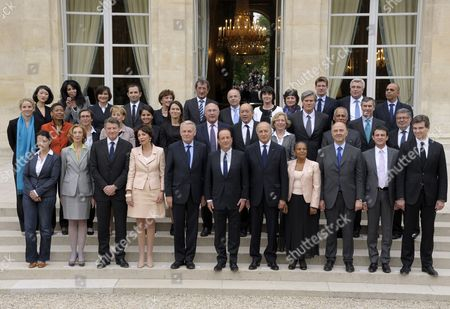 French President Francois Hollande (c) Poses For a Family Picture with Members of His New Government After Their First Cabinet Meeting at the Elysee Palace in Paris France 17 May 2012 From Top - Jm For Junior Minister and M For Minister (1st Row L to R) Junior Minister For Smes Innovations and Digital Economy Fleur Pellerin; Junior Minister For French Living Abroad and Francophony Yamina Benguigui; Junior Minister For Disabled People Marie-arlette Carlotti; Junior Minister For Social and Solidarity Economy Benoit Hamon; Junior Minister For the Elderly and Disabled Michele Delaunay; Junior Minister For Cities Francois Lamy; Junior Minister For European Affairs Bernard Cazeneuve; Junior Minister For Handicraft Tourism and Trade Sylvia Pinel; Junior Minister For Family Dominique Bertinotti; Junior Minister For Foreign Countries and Development Pascal Canfin; Junior Minister For Transports and Maritime Economy Frederic Cuvillier; Junior Minister For Veterans Kader Arif (2nd Row) Junior Minister For Justice Delphine Batho; Junior Minister For Educational Success George Pau-langevin; Sports and Youth Minister Valerie Fourneyron; Minister For State Reform Decentralisation and Public Administration Marylise Lebranchu; Minister For Women's Rights and Government Spokeperson Najat Vallaud-belkacem; Minister For Culture and Communication Aurelie Filippetti ; Labour Employment and Social Dialogue Michel Sapin; Defence Minister Jean-yves Le Drian; Minister For Higher Education and Research Genevieve Fioraso; Agriculture Minister Stephane Le Foll; Minister For Overseas Territories Victorin Lurel; Junior Minister For Budget Jerome Cahuzac; Junior Minister in Charge of Relations with the Parliament Alain Vidalies (3rd Row) Minister For Equality of Territories and Housing Cecile Duflot; Minister For Ecology Sustainable Development and Energy Nicole Bricq; Education Minister Vincent Peillon; Social Affairs and Health Minister Marisol France Paris
