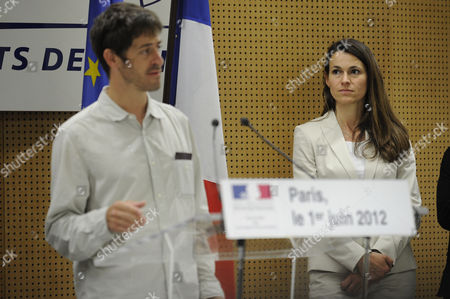 Stock Photo of French Culture Minister Aurelie Filippetti (r) Listens to the Speech of French Journalist Romeo Langlois (l) Newly Freed by Colombian Rebels As He Speaks to Journalists Upon His Arrival at Paris Roissy Airport Near Paris France 01 June 2012 the 35-year-old Journalist was Accompanying Colombian Soldiers on a Cocaine-lab Destruction Mission on April 28 when Rebels Attacked France Roissy