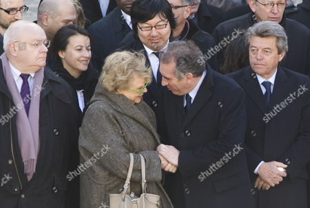 Europe Ecologie-les Verts (eelv) Party Candidate For the 2012 French Presidential Election Eva Joly (c-l) Shakes Hands with Democratic Movement (modem) Party Candidate For the 2012 French Presidential Election Francois Bayrou (c-r) As They Attend the Funeral Ceremony Honoring World War Ii French Resistance Leader Raymond Aubrac at the Invalides Monument Paris France 16 April 2012 Aubrac a Major Leader in the French Resistance is Famed For a Daring Escape After Being Captured by the Nazis During World War Ii Alongside French Resistance Hero Jean Moulin Aubrac Died at the Age of 97 in Paris 10 April 2012 Also in Picture Eelv Green Party Head Cecile Duflot (2-l) and Ump Political Party Deputy Alain Joyandet (r) France Paris