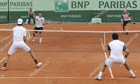 Daniele Bracciali (2nd L) and Potito Starace (r) Both of Italy in Action During Their Men's Doubles Quarter Final Match Against Ivan Dodig of Croatia and Marcelo Melo of Brazil For the French Open Tennis Tournament at Roland Garros in Paris France 04 June 2012 France Paris
