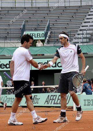 Daniele Bracciali (l) and Potito Starace (r) Both of Italy React During Their Men's Doubles Quarter Final Match Against Ivan Dodig of Croatia and Marcelo Melo of Brazil For the French Open Tennis Tournament at Roland Garros in Paris France 04 June 2012 France Paris