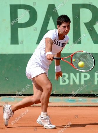 Carla Suarez Navarro of Spain Returns to Tamarine Tanasugarn of Thailand During Their First Round Match For the French Open Tennis Tournament at Roland Garros in Paris France 28 May 2012 France Paris