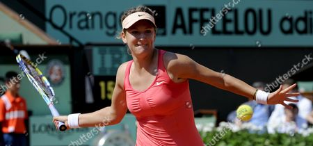Stock Photo of Victoria Azarenka of Belarus Returns to Alberta Brianti of Italy During Their First Round Match For the French Open Tennis Tournament at Roland Garros in Paris France 28 May 2012 France Paris