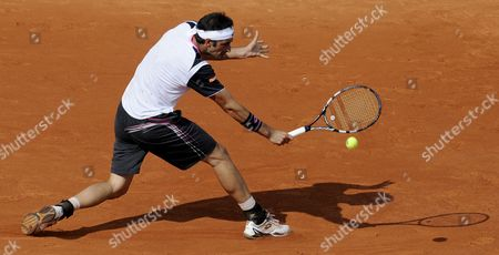Potito Starace of Italy Returns to Novak Djokovic of Serbia During Their First Round Match For the French Open Tennis Tournament at Roland Garros in Paris France 28 May 2012 France Paris