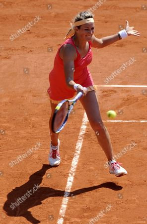 Stock Picture of Victoria Azarenka of Belarus Returns to Alberta Brianti of Italy During Their First Round Match For the French Open Tennis Tournament at Roland Garros in Paris France 28 May 2012 France Paris