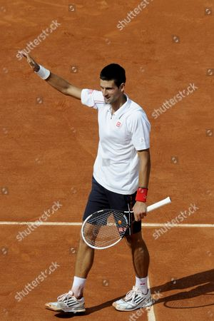 Novak Djokovic of Serbia Celebrates Winning His First Round Match Against Potito Starace of Italy For the French Open Tennis Tournament at Roland Garros in Paris France 28 May 2012 France Paris