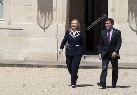 United States Secretary of State Hillary Clinton (l) Arrives at the Elysee Palace Together with the Us Ambassador to France Charles H Rivkin (r) After a 'Friends of Syria' Summit was Held in Paris France 06 July 2012 France Paris