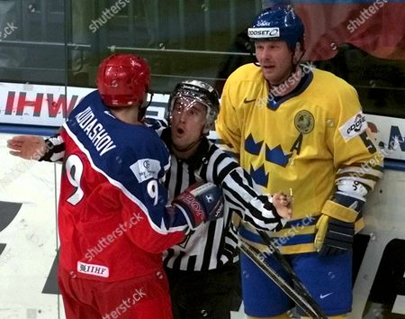 St Petersburg Russian Federation : a Referee (c) Separates Swedens Peter Andersson (r) From Russias Alexei Kudashov (l) During Their Second Round Match at the Ice Hockey World Championship in St Petersburg Tuesday 09 May 2000