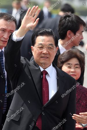 Chinese President Hu Jintao (l) and His Wife Liu Yongqing (r) Wave to Media As They Arrive in New Delhi India 28 March 2012 to Attend the Fourth Brazil Russia India China South Africa (brics) Summit the Summit to Be Hosted by the Indian Prime Minister Manmohan Singh on 29 March 2012 and to Be Attended by Presidents Dilma Rousseff of Brazil Dmitry Medvedev of Russia Hu Jintao of China and Jacob Zuma of South Africa This Summit Will Be Focused on the Theme 'Brics Partnership For Global Stability Security and Prosperity' India New Delhi