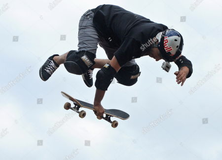 Stock Picture of Sandro Dias of Brazil a Member of the Extreme Sports Stars Team Shows His Skills with the Skateboard As Part of the 'Mountain Dew Xtreme Tour' in the Southern Indian City of Bangalore 21 April 2012 an International Team of Ten Professional Skaters Bikers and Boarders Display Their Skills in Skateboarding Bmx Inline Skating and Freestyle Motocross (fmx) For the First Time in India the 'Xtreme Tour' Will Also Travel to Other Cities in India Like Noida Kanpur Gurgaon Delhi and Chandigarh India Bangalore