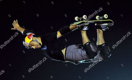 Stock Photo of Sandro Dias of Brazil a Member of the Extreme Sports Stars Team Shows His Skills on the Skateboard As Part of the 'Mountain Dew Xtreme Tour' in the Southern Indian City of Bangalore 22 April 2012 Evening an International Team of Ten Professional Skaters Bikers and Boarders Displays Their Skills in Skateboarding Bmx Inline Skating and Freestyle Motocross (fmx) For the First Time in India the 'Xtreme Tour' Will Also Be Shown in Other Indian Cities India Bangalore