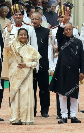Outgoing Indian President President Pratibha Patil (l) and India's New President Pranab Mukherjee (r) Greet People During a Ceremony at Indian President House in New Delhi India 25 July 2012 Veteran Lawmaker Government Troubleshooter and Indian National Congress Party Loyalist Pranab Mukherjee Crowned a Four-decade Career in Politics by Becoming India's 13th President India New Delhi