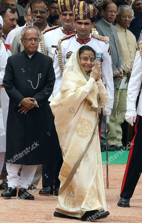 Outgoing Indian President President Pratibha Patil Greet People and Walks As India's New President Pranab Mukherjee (l) Looks on at a Ceremony at Indian President House in New Delhi India on 25 July 2012 Veteran Lawmaker Government Troubleshooter and Indian National Congress Party Loyalist Pranab Mukherjee Crowned a Four-decade Career in Politics by Becoming India's 13th President India New Delhi
