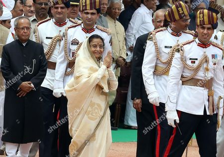 Outgoing Indian President President Pratibha Patil (c) Greets People As India's New President Pranab Mukherjee (l) Looks on During a Ceremony at Indian President House in New Delhi India on 25 July 2012 Veteran Lawmaker Government Troubleshooter and Indian National Congress Party Loyalist Pranab Mukherjee Crowned a Four-decade Career in Politics by Becoming India's 13th President India New Delhi