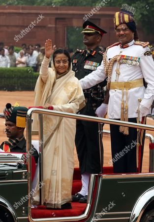 Outgoing Indian President President Pratibha Patil (l) Waves the Crowds As She Reviews the Guard of Honour During a Welcome Ceremony For the Newly Elected President Pranab Mukherjee at Indian President House in New Delhi India 25 July 2012 Veteran Lawmaker Government Troubleshooter and Indian National Congress Party Loyalist Pranab Mukherjee Crowned a Four-decade Career in Politics by Becoming India's 13th President India New Delhi