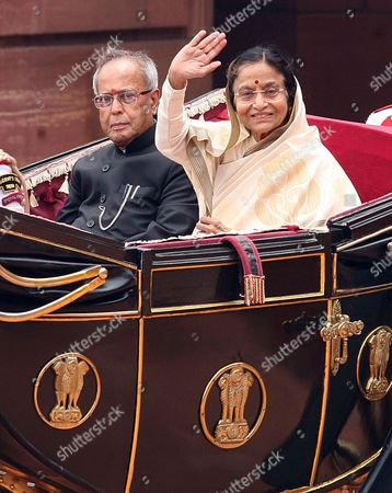 Stock Image of India's New President Pranab Mukherjee Wave (l) and Outgoing President Pratibha Patil ( R) Greet People As They Arrives For a Ceremony at Indian President House in New Delhi India on 25 July 2012 Veteran Lawmaker Government Troubleshooter and Indian National Congress Party Loyalist Pranab Mukherjee Crowned a Four-decade Career in Politics by Becoming India's 13th President India New Delhi