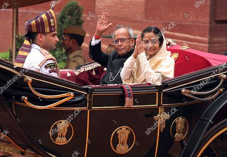 Stock Picture of India's New President Pranab Mukherjee Wave (l) and Outgoing President Pratibha Patil ( R) Greet People As They Arrives For a Ceremony at Indian President House in New Delhi India on 25 July 2012 Veteran Lawmaker Government Troubleshooter and Indian National Congress Party Loyalist Pranab Mukherjee Crowned a Four-decade Career in Politics by Becoming India's 13th President India New Delhi