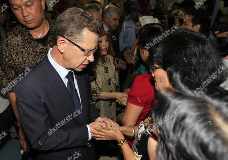 Russian Ambassador Alexander Ivanov (l) Talks to Relatives of the Sukhoi Superjet-100 Victims Shortly Before a Press Conference Following Sukhoi Super Jet 100 Crash at Halim Perdana Kusuma Airport in Jakarta Indonesia 11 May 2012 a Russian Team Arrived in Indonesia on 11 May to Investigate the Crash of a Russian Passenger Jet with Up to 47 Passengers on Board the Sukhoi Superjet 100 Ploughed Into a Mountain Near Jakarta on 09 May and Rescuers Found the Wreckage on 10 May No Survivors Were Found Indonesia Jakarta