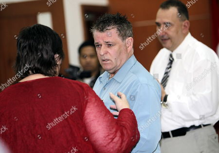 Australian Bali Bombing Victim Peter Hughes (c) Listens to Australian Embassy Officers Before Giving His Testimony During Indonesian Militant Umar Patek's Trial in Jakarta Indonesia 05 April 2012 Umar Patek is Accused of Mixing Explosive Materials Used in the 2002 Bali Nightclub Attacks That Killed 202 People Patek Faces Six Counts Including Premeditated Murder Bomb-making and Illegal Firearms Possession and Could Face the Death Penalty if Found Guilty Indonesia Jakarta